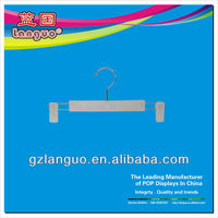 White plastic pants hangers with clips