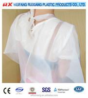 Sample free pe plastic uniform for beauty salon