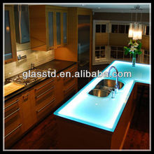 Fusion of glass countertop with sink
