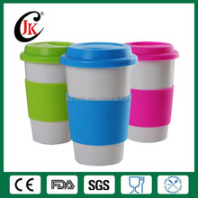 Wholesale porcelain promotional coffee mug white ceramic mug with silicone lid and sleeve