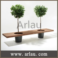 Outdoor wood bench with tree planter