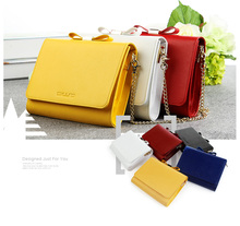 2015 hot selling women's leather clutch bag lady handbag with shining metal chain in red color