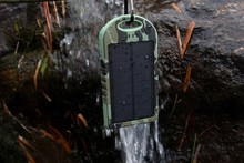 Waterproof/Dustproof/shockproof/skidproof solar mobile charger with Enviromental ABS fireproof material and rubber paint surface