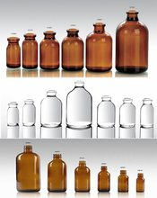 amber and clear boston round glass and plastic bottle