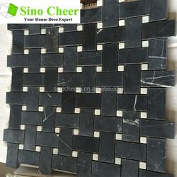 The black basketweave marble mosaic tile with white dots for backsplash