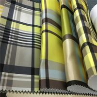 100% polyester yarn dyed sofa fabric/popular african man-made silk polyester fabric ready made curtain sofa fabric
