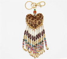 leopard beaded key chain of heart shape with leather and clay beads
