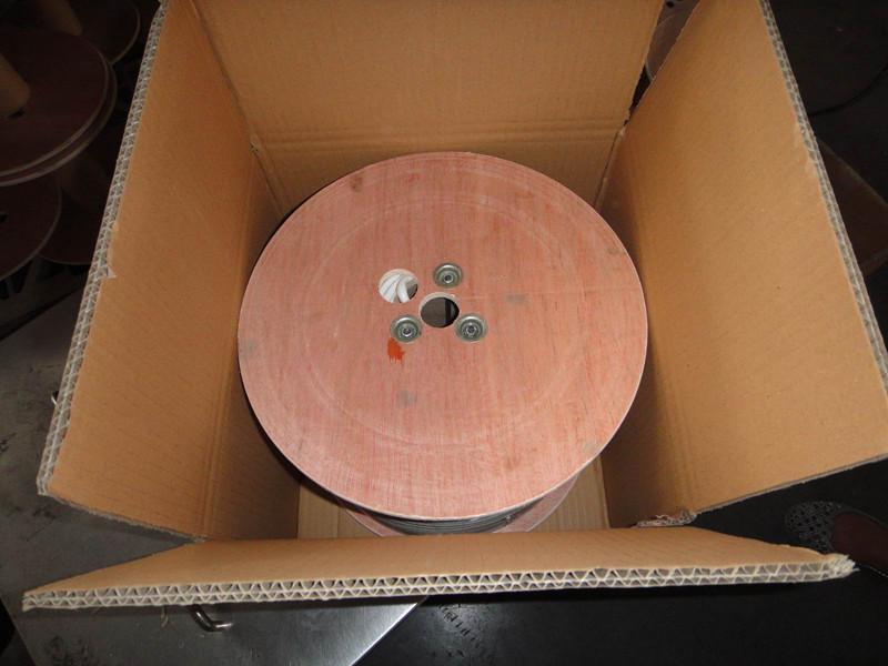 wooden spool in carton