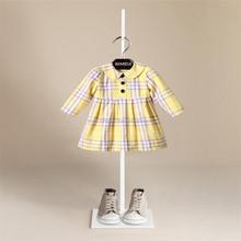 Virgen niña doble de la primavera y período de otoño y la falda de la muchacha de manga larga paño de la rejilla