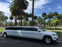 SUV Limo: 2015 White 140-inch stretch Jeep Grand Cherokee Stretch Limousine for Sale #1429