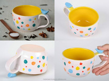 White cup with multi-colored dots