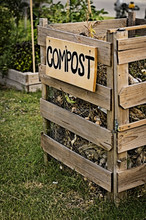 Solid waste composting product to convert biodegradable waste into manure for plant use