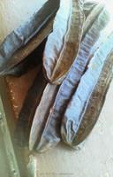 empty cocoa pods, palm fruits chaff, cola nuts, finger pepper, gavanor, coconut cake