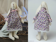 Handmade small fabric soft toy rabbit girl in dress with violet floral pattern